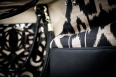 Abstract patterns merge to create a winning combination of chic. Mondani Handbags